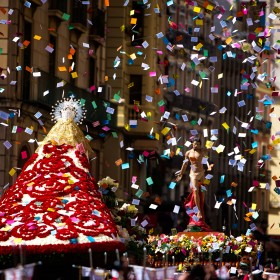 Spain is known especially for its Holy Week traditions or Semana Santa. Throughout the country, brotherhoods carry magnificent floats with sculptures that depict different scenes from the gospels related to the Passion of Christ or the Sorrows of Virgin Mary. On the Sunday of Resurrection, the processions are jubilant with no faces covered, usually carrying sculptures of Jesus and Mary, and including an encounter of those floats. In Alicante, Nuestra Señora de la Alegría leaves the Basílica Santa María and meets with Jesus on the Plaza del Ayuntamiento, facing the city's town hall.