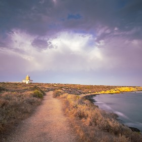 Tabarca island Alicante Spain on July 2020: Nova Tabarca is the largest island in the Valencian Community, and the smallest permanently inhabited islet in Spain. It is known for its marine reserve. The lighthouse by sunset.